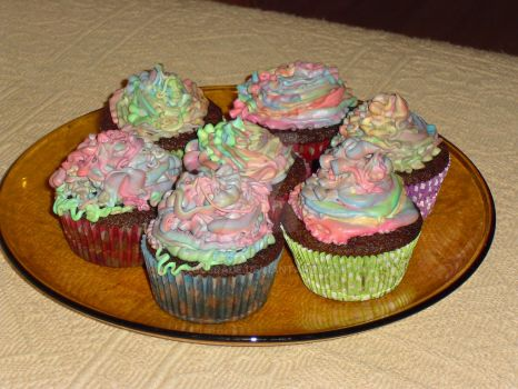Rainbow cupcakes by Xquerade