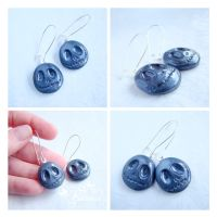 Metallic jack's head earrings by caithness-shop