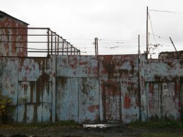Rusty gate with barbed wire. by DiamondNozzle