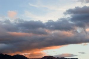 NZ Sunset sky orange dark clouds by Chunga-Stock
