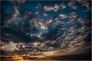 Setting Sun In An Explosion Of Clouds by mastermayhem
