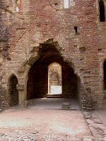 ruined castle entrance by the-alyshleigh-stock