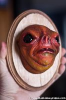 A wall mounted head of a Pygmy Blood Troll by FoxH