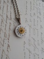 Steampunk necklace with dial of the watch and gear by SteamJo