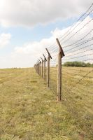 Barbed wire fence III by CULAter-stock