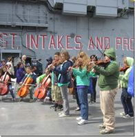 NYC Orchestra Trip-Performing on the Flight Deck by Northwestern-Viola13