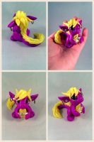 Purple and Yellow Star Dragon by HereThereBeSculpture