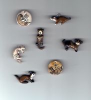 All my other ferret pendants by spookyweasel