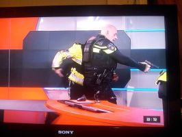 POLICE IN TV ARESTING GUNMAN ON THE NEWS by DAGAIZM