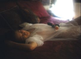 Girl on bed with flower by GossamerDreams