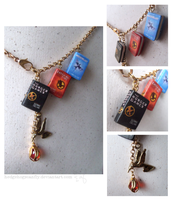 Hunger Games book necklace by Hedgehogscanfly