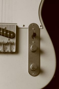 white vintage guitar by Jhickling