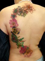 flowers on back tattoo by asussman