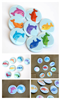 Rainbow of Dolphins Buttons - Blue Background by artshell