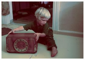 an old clock and a young boy by sipsic