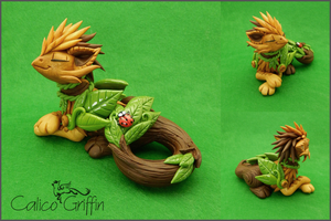 Kazu the forest griffin by CalicoGriffin