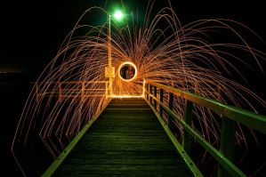 Steel wool on a Pier by DanielleMiner