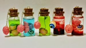 Bottles of Guts Charms. by Darxen