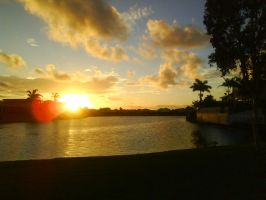 pelican waters sunset... by RubyReminiscence