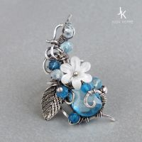 silver floral ear cuff with blue gemstones by JSjewelry