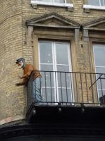 man leaning on balcony by thebluemaiden