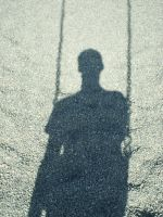 Emo kid on a swing's shadow by sauerkraus