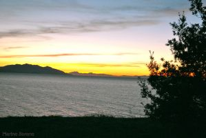 sunset behind the elba island by mimmi95