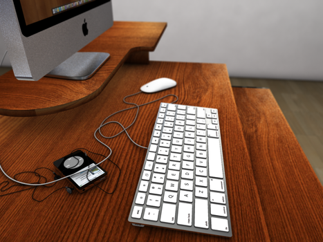 imac and ipod on a desk by endri
