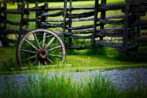 Wagon Wheel and old fence by TearsofEndearment