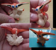 Victini Charm Commission by FallenAngelKrisi