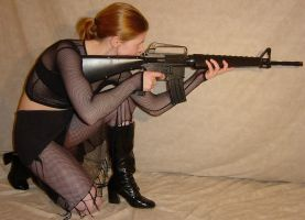 Jodi Black Fishnet Aims Rifle by FantasyStock