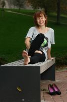 Lea exposing her soles on a bench by foot-portrait
