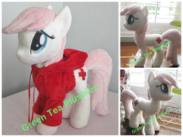 Nurse Redheart plush wearing red hoodie by GreenTeaCreations