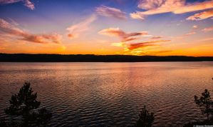 Sunset at lake Voxen in Sweden by JoInnovate