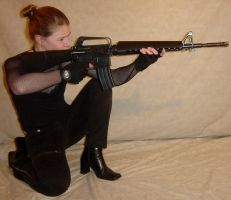 Jodi Aiming Rifle Crouching by FantasyStock