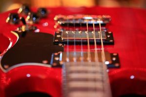 Red Guitar by BusterBrownBB