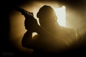 Backlit Man with Gun by hmcindie