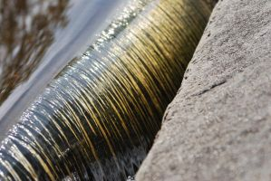 Golden water flow. by CapnSarah