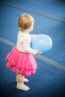 Baby girl in tutu holding a balloon by Sinned-angel-stock