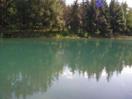 A pond with sky-blue water 3 by stock1-2-3