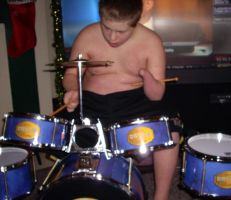 Down's syndrome playing drums by Buhla