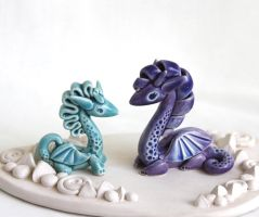 Lavender and turquoise dragons by vavaleff