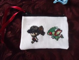 Cross stitch Flygon and trainer pouch by Miloceane