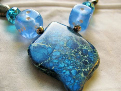 Tribal blues, metallic dice necklaces by SomethingTeal