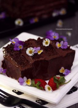 Dark Chocolate Cake with Edible Flowers by theresahelmer