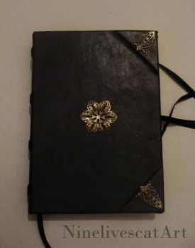 Leather notebook by NinelivescatArt
