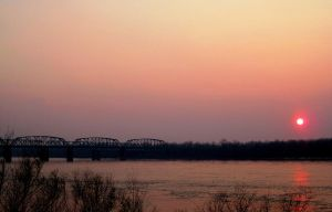 sunset on the Mississippi by InnocentThora