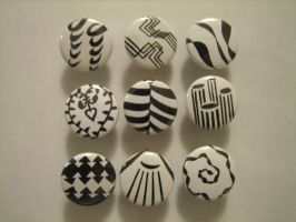 Black and white buttons by flameinheaven