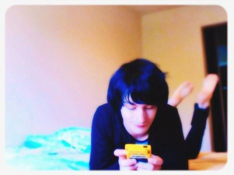 Playing Pokemon Yellow...on a Yellow Gameboy by picsxd