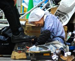 the old shoe shine woman by tobitt